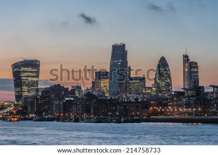 New skyscrapers of the City of London at sunset 2014 including 20 Fenchurch Street, 122 Leadenhall Street, The Gherkin and the Heron Tower - stock photo