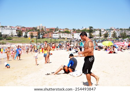 NEW SOUTH WALES, AUSTRALIA - JANUARY 24 : Traveler and Australian people come to Bondi Beach for relax and swimming or surfing at Sydney on January 24, 2015 in New South Wales, Australia. - stock photo