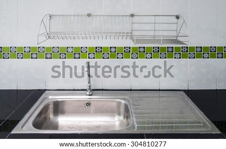New stainless sink in the modern kitchen. - stock photo