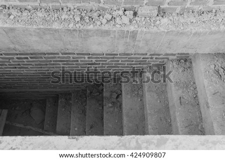 New stairs architecture unfinished at basement. Cement concrete staircase on construction site - stock photo