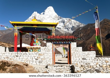 New statue of buddha in Pangboche monastery and mount Ama Dablam, Khumbu valley near Tengboche, way to Everest base camp, Nepal - stock photo