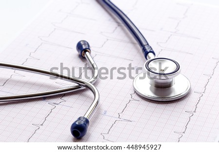new stethoscope on a white background with cardiogram isolated - stock photo