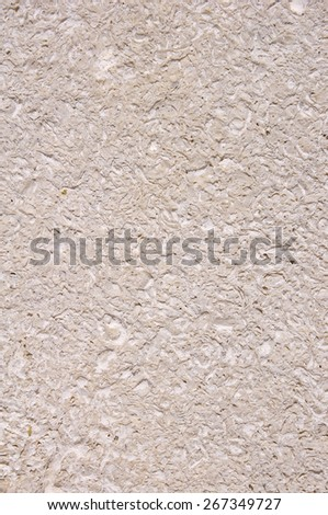 New stone cladding plate on wall closeup  - stock photo