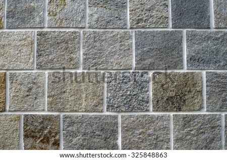 New stone cladding plates on the wall closeup  - stock photo