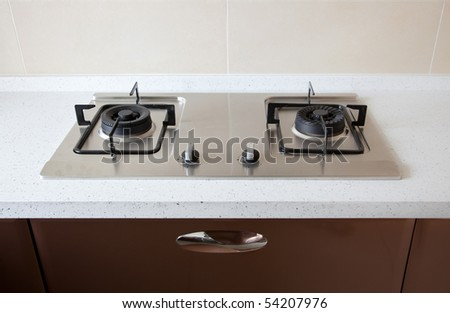 New stove on mable plate in a modern kitchen - stock photo