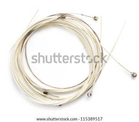 new string from a guitar on a white background. macro - stock photo