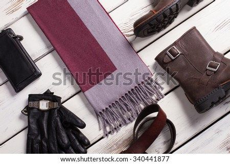 New stylish men's accessories and clothing on store shelf. - stock photo