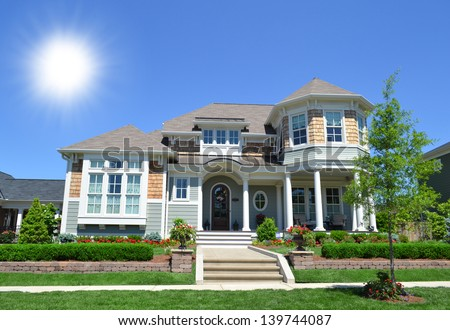 New Suburban Dream Home on a Sunny Day - stock photo