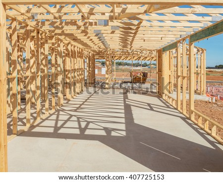 New suburban home construction  framing at noon - stock photo