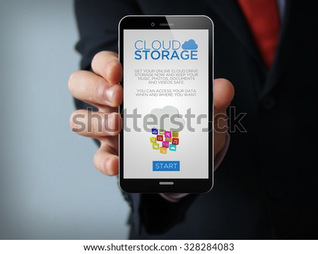 new technologies business concept: businessman hand holding a 3d generated touch phone with cloud storage website on the screen. Screen graphics are made up.