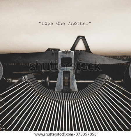 New Testament Scripture quote Love One Another by vintage typewriter - stock photo