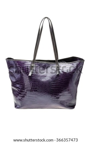 New textured violet womens bag isolated on white background. - stock photo