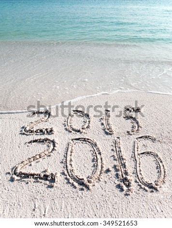 New 2016. The wave washes off an inscription 2015.