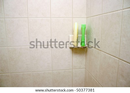 New tile shower space with shampoo shelf. - stock photo