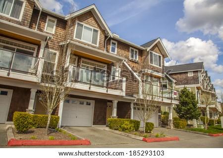 new townhouses or condominiums  - stock photo