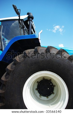 New tractor with big tires - stock photo