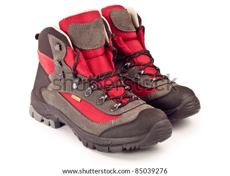 New trekking boots on white background - stock photo