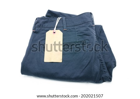 New trouser and tag isolated on white - stock photo