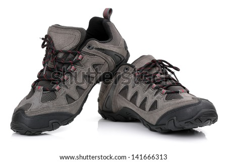 New unbranded hiking shoes or boots isolated on white - stock photo