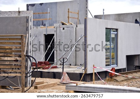 new urban house building construction work place - stock photo