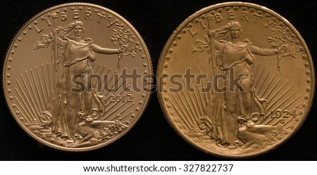 New US Gold Eagle Coin vs. Old US Gold Double Eagle Coin - stock photo