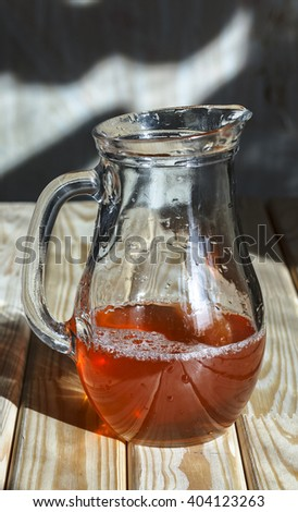 New wine in a glass decanter on a wooden table. Top view, close-up - stock photo