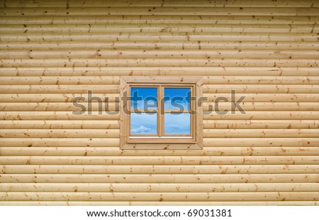 New Wooden cottage exterior facade wall with closed window - stock photo