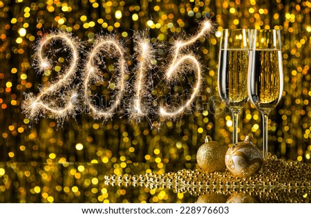 New Year - 2015 against the background of glasses of champagne and Christmas balls - stock photo