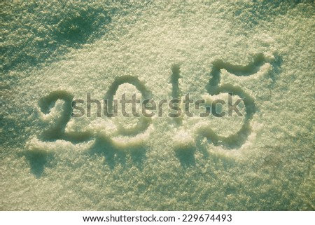 new year and christmas background,text  2015 on the snow. Retro toned - stock photo