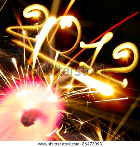 new year 2012 and sparkler on fire - stock photo