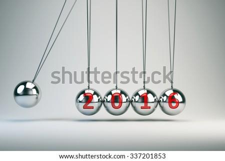 New Year 2016 - Balancing Balls Newton's Cradle - stock photo