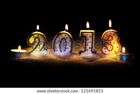 new year 2013 - candles with snow - stock photo