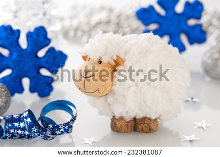 New year card with a sheep a symbol of 2015 on christmas decoration - stock photo