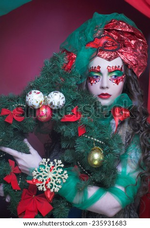 New Year Carnival. Portrait of young woman with holiday decoration. - stock photo