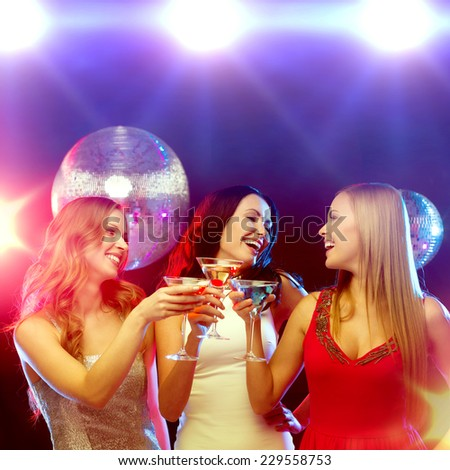new year celebration, friends, bachelorette party, birthday concept - three women in evening dresses with cocktails and disco ball - stock photo