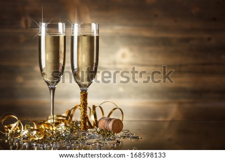 New Year Celebration with two champagne glasses - stock photo