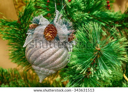 New Year, Christmas decorations on fir branches, Christmas toys, retro, vintage, old-style photo - stock photo