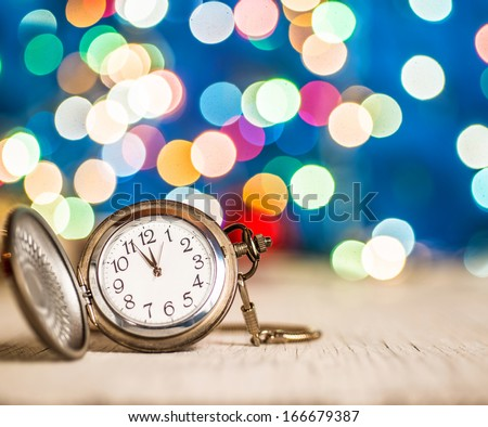 New year clock on abstract background - stock photo