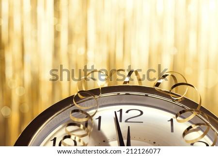 New year clock on festive background - stock photo