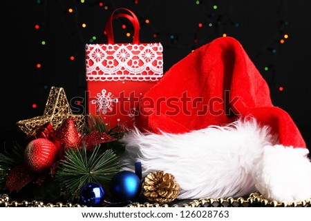 New Year composition of New Year's decor and gifts on Christmas lights background - stock photo