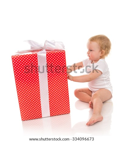 New year 2016 concept child baby toddler kid with Christmas present gift for celebration isolated on a white background - stock photo