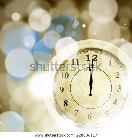 New year concept: Clock with bokeh lights showing 12am.  - stock photo