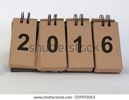 New Year 2016 concept, desk standing paper on white background with message new year 2016 - stock photo