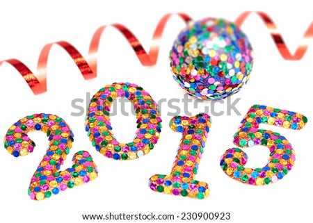 New Year 2015 decoration, colorful digits, ball and serpentine - stock photo