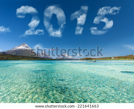 new year 2015 digits on sky over blue ocean - stock photo