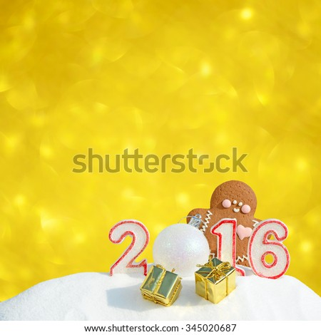 New Year 2016. Figure 2016, Christmas balls, gifts and gingerbread man on glitter background - stock photo