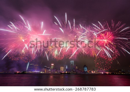 New Year Fireworks at Victoria Harbor in Hong Kong - stock photo
