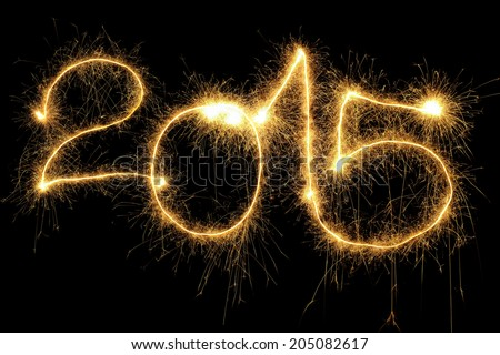 New Year 2015 formed from sparking digits over black background - stock photo