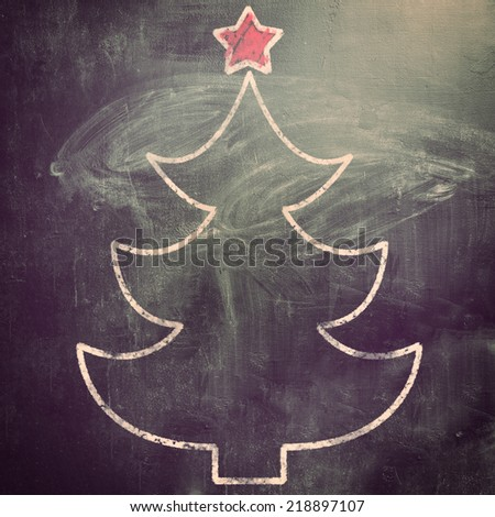 new year, fur tree on chalk board for christmas - stock photo