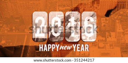 New year graphic against composite image of businesspeople going to shake hands - stock photo